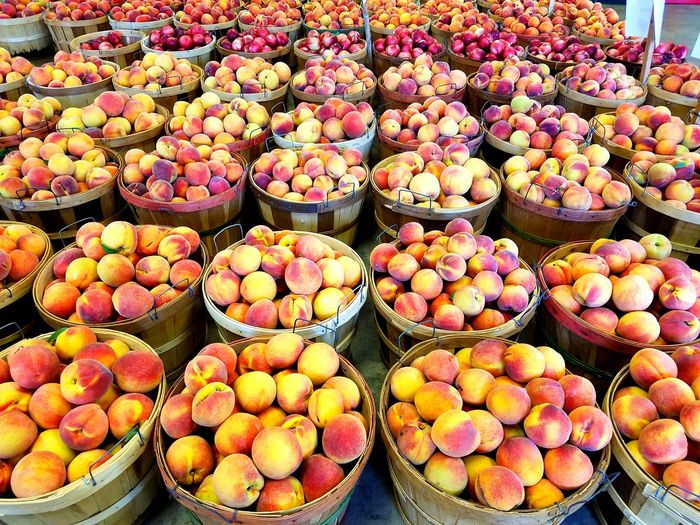 High Angle View Of Peaches In Containers At Market For Sale