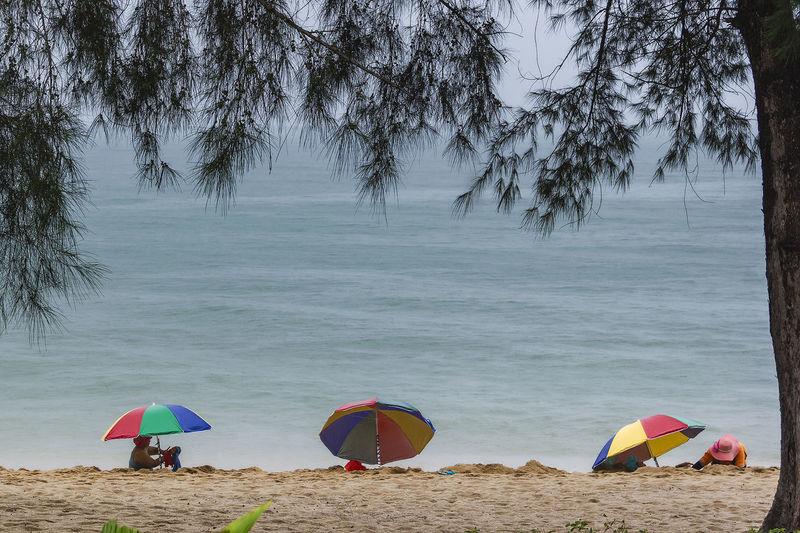 Thap sakae villagers make sand spas for tourists at thap sakae beach prachuap khiri khan, thailand.