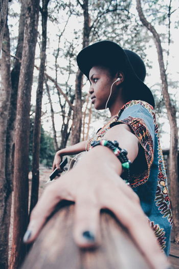 Tree One Person Forest Outdoors Women Nature Young Adult Teenagers  Casual Clothing Rural Scene Africa Fashion African Fashion EyeEm Gallery Focus On Foreground Lifestyles Canon Camera Portrait Fresh on Market 2017 Winter Detail Vacations Leisure Activity Day