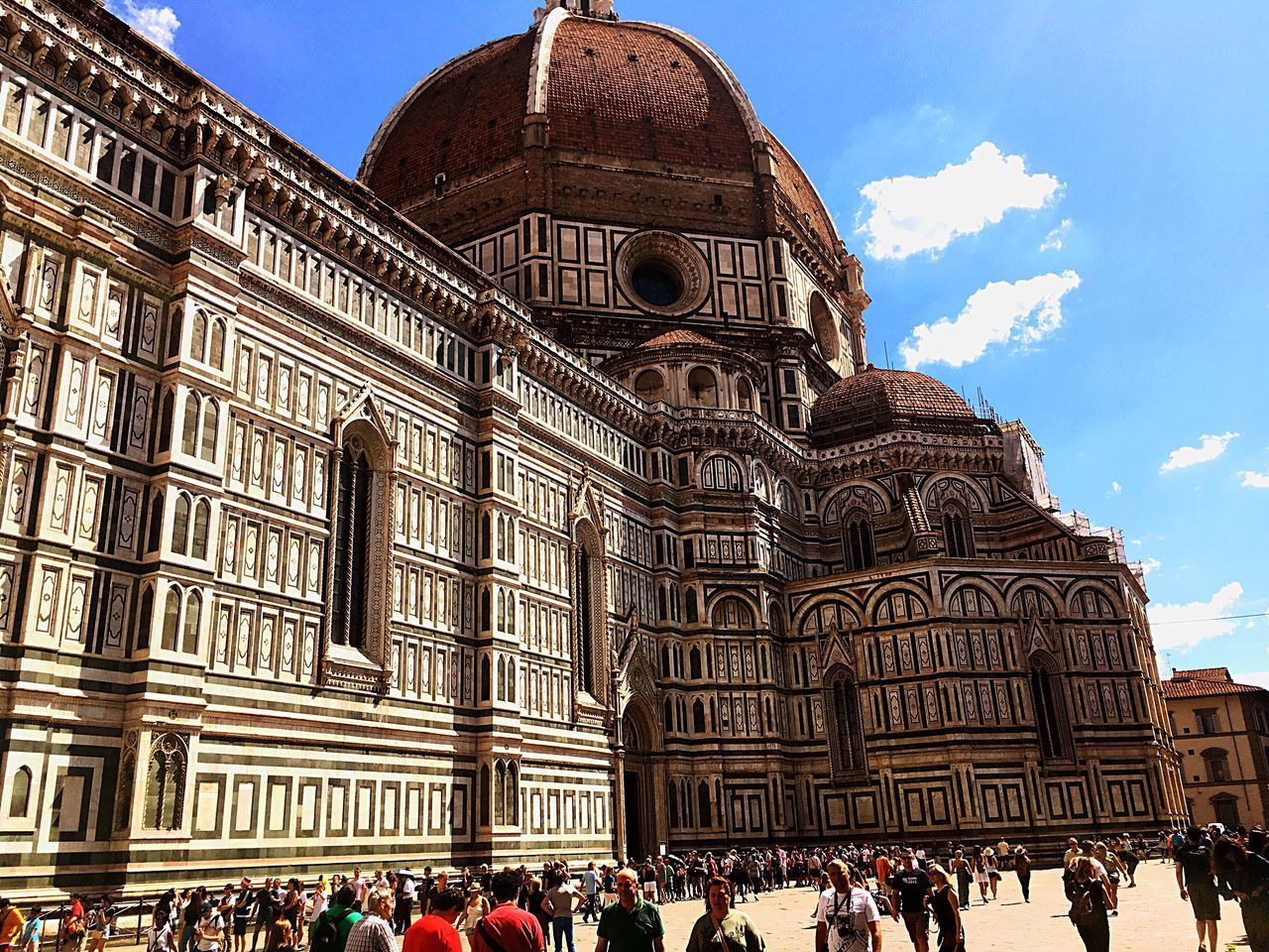 architecture, large group of people, building exterior, built structure, sky, history, travel destinations, cloud - sky, day, real people, place of worship, religion, spirituality, tourism, men, outdoors, travel, leisure activity, women, dome, lifestyles, adult, people