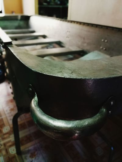 Close-up of old tea cup on table