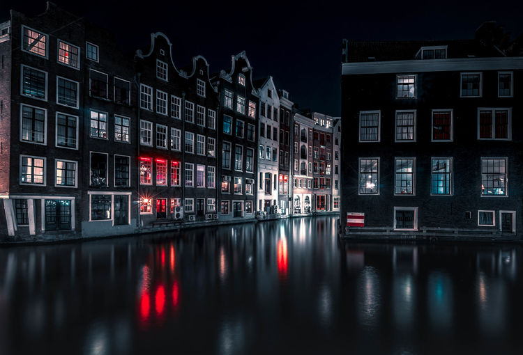 Reflection Of Illuminated Buildings In Water