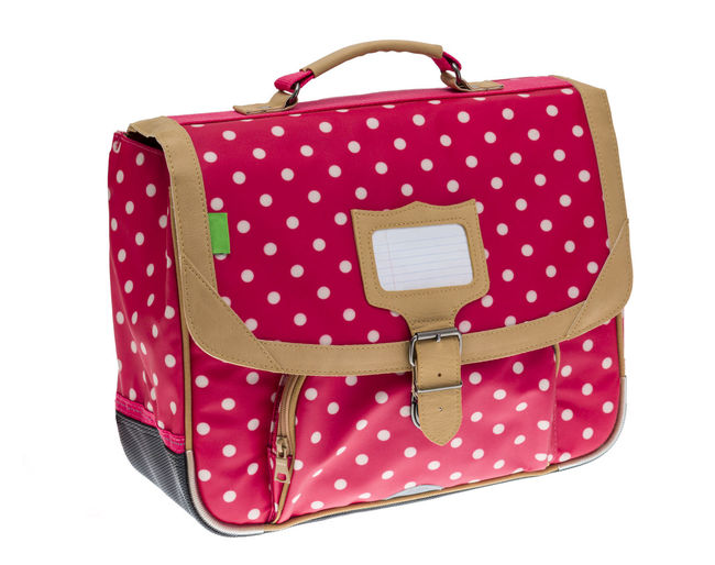 Fancy red schoolbag with white dots isolated against a white background. White Background Studio Shot Cut Out Fashion Pink Color Pattern Single Object Luggage Bag Suitcase Travel Spotted Close-up Schoolbag Object Isolated Isolated On White Isolated White Background Childhood