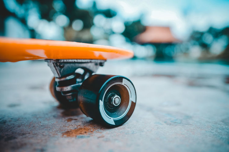 Children Close-up Focus On Foreground Leisure Orange Color Poolside Selective Focus Single Object Skateboard Sport Still Life Toy Wheel Wheels