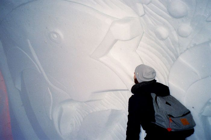 Snow fish 35mm Film Fish Snowcountry Winter Snow One Person Cold Temperature Rear View Real People Leisure Activity Walking Warm Clothing Backpack Lifestyles Full Length Standing Adventure