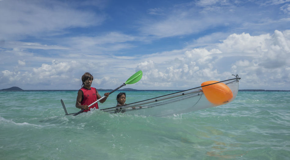 Father and Son in the boat at Sibuan Island Bajau Laut Sibuan Island, Boat Father And Son Sea And Sky Lifestyles Two People Transportation Men Beauty In Nature Outdoors Water Sea Sky Real People Nature