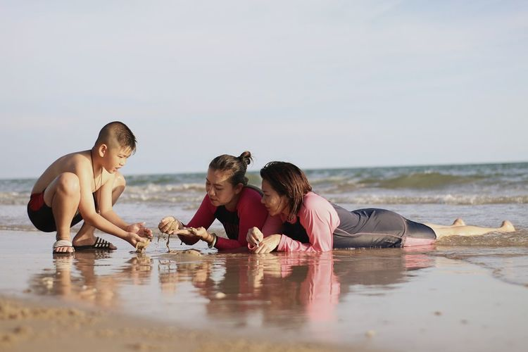 Mother with children at beach
