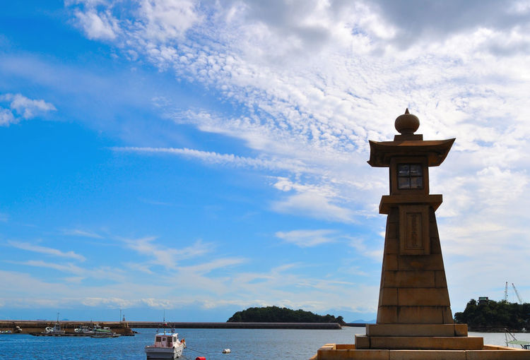 Sky Cloud - Sky Water Architecture Built Structure Nature Building Exterior Tower Travel Destinations Day Sea Building Travel No People Lighthouse Tourism Scenics - Nature History Sculpture Guidance Outdoors
