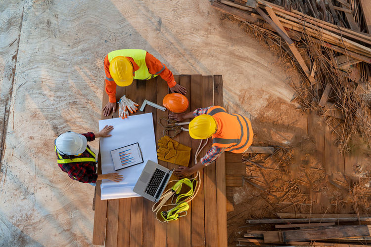 High angle view of working on table at construction site