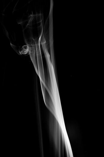 Abstract Black Background Black Color Burning Changing Form Close-up Complexity Copy Space Flowing Incense Indoors  Luminosity Motion Moving Up Natural Pattern No People Pattern Smoke - Physical Structure Studio Shot Swirl Transparent Veil White Color