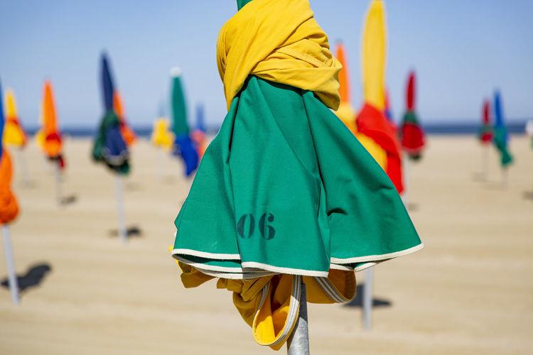 Closed beach umbrellas at beach