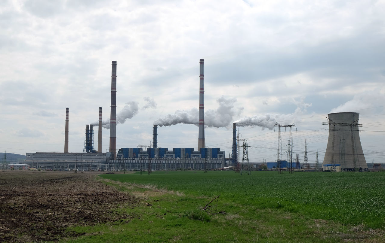 industry, factory, sky, smoke stack, smoke - physical structure, building exterior, environment, environmental issues, built structure, fuel and power generation, nature, pollution, architecture, cloud - sky, day, land, field, outdoors, emitting, no people, air pollution, cooling tower, ecosystem, atmospheric