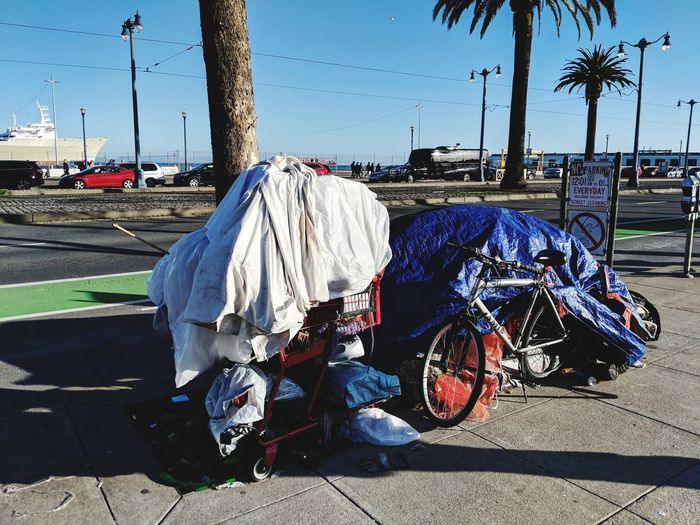 A common sight in the most expensive city in the United States...homeless carts. Homeless In San Francisco Homeless In America Homelessness  Homeless San Francisco, California No People Embarcadero Waterfront Water Shadow Sunlight Tree Sky