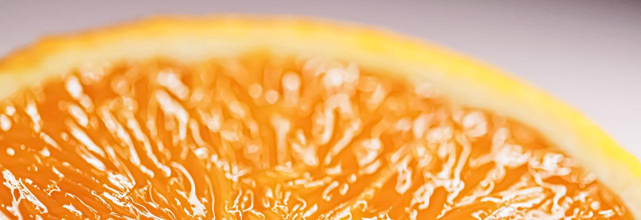 Close-up of orange over white background