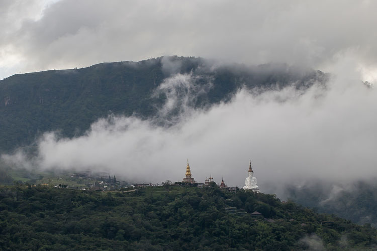 Phra that pha son kaew temple in the mist at khao kho, phetchabun, thailand