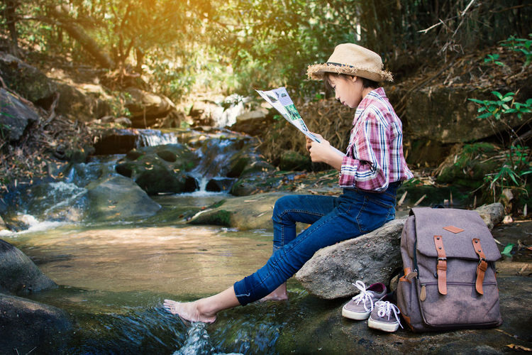 Map Reading Backpack Bag Day Forest Girl Nature One Person Outdoors Relax Rock - Object Sitting Water Waterfall