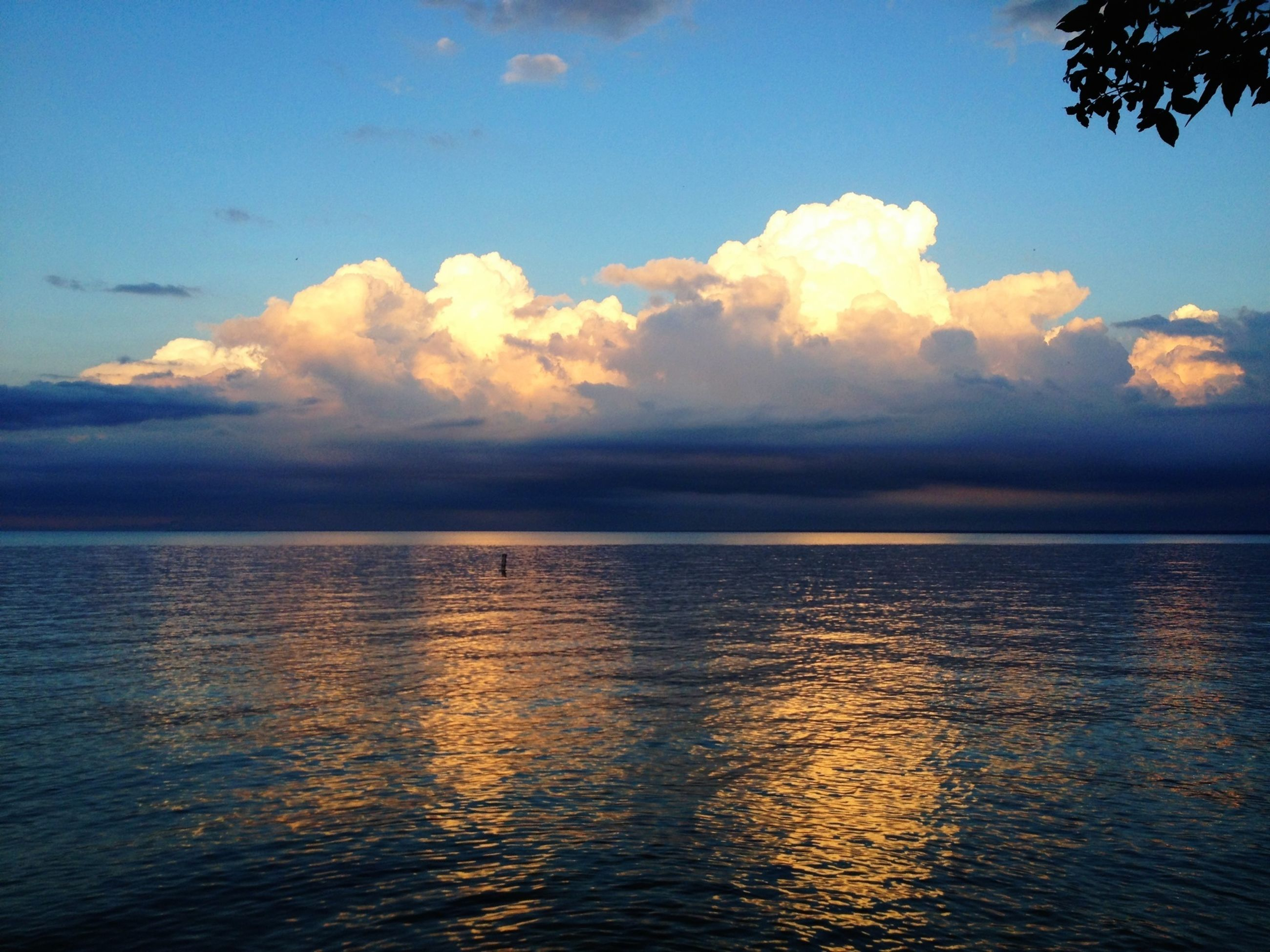 water, tranquil scene, sky, tranquility, scenics, sea, beauty in nature, waterfront, horizon over water, cloud - sky, nature, cloud, rippled, idyllic, sunset, blue, reflection, calm, cloudy, outdoors