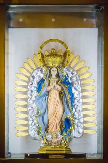 Madre de Guadalupe Guadalupe Coronation  Gold Colored Painted Image Religion Art And Craft Close-up Virgin Mary Statue