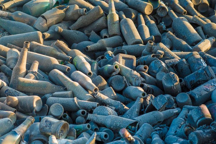 Glass waste bottles