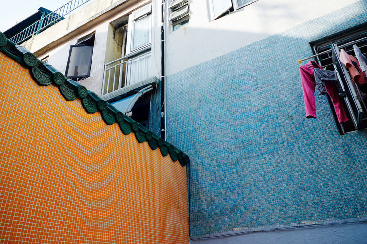 Spotted these colourful, tiled walls on Cheung Chau island, Hong Kong. Architecture Balcony Blue Building Exterior Color Palette Colorful Colors Contrast Drying Clothes Exterior House Low Angle View Mosaic No People Orange Tiles