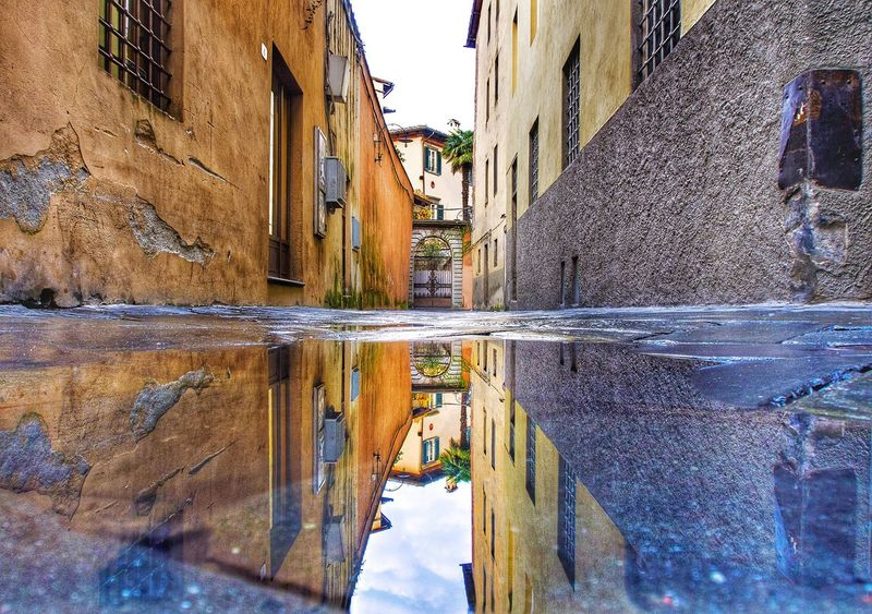 Reflectio from a puddle in the city of Lucca in Ruscany, Italy Reflection Puddle Water City Mirror HDR Lucca Italy Omdem5 Streetphoto Colorful Winter RainyDay Outdoor Tuscany Bottomview Urban Citylandscape Twins Double Littleroad Littlestreet Vintage Old Old Buildings