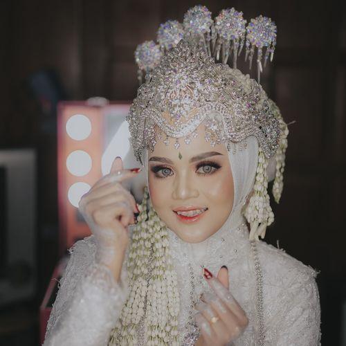 Portrait of bride wearing make up
