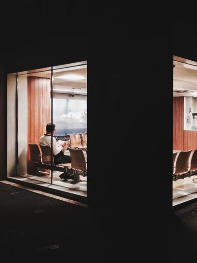 Man sitting in front of window