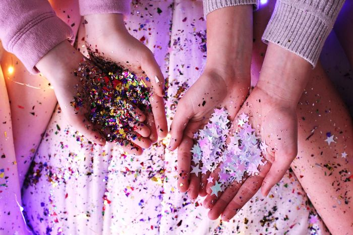 Celebration Human Body Part Multi Colored Confetti Fun Human Leg Low Section Togetherness Human Hand Real People Women Indoors  Close-up Only Women Friendship People Adult Glitter Holi