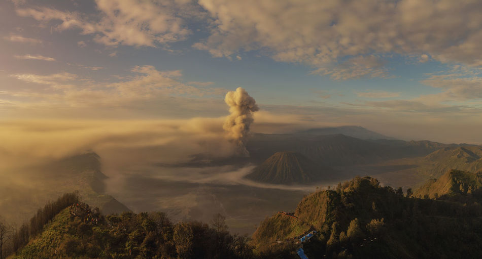 Aerial View of Mount Bromo Cloud - Sky Sky Scenics - Nature Beauty In Nature Mountain Tranquil Scene Tranquility Non-urban Scene Environment Nature Idyllic Landscape Sunset No People Volcano Smoke - Physical Structure Geology Day Physical Geography Mountain Range Outdoors Volcanic Crater Power In Nature Mountain Peak