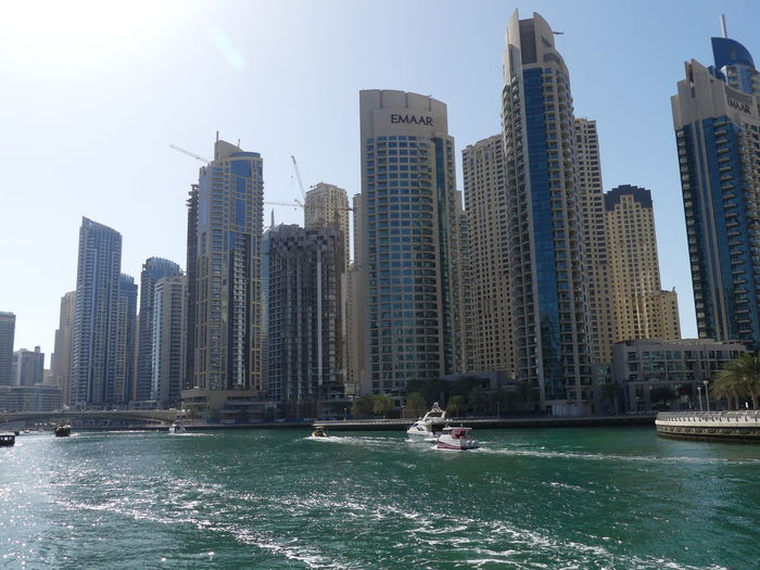 Skyscrapers other end of the Marina, Dubai, United Arab Emirates 2019 Dubai 2019 Marina UAE Blue Sky Sunlight And Shade Water Waterfront Scyscrapers City Tall - High Nautical Vessel Urban Skyline Towers Tower Blocks Cityscape No People Low Angle View Glassy Water Boats Modern Architecture Modern Design Glass And Steel Structure Composition Outdoor Photography