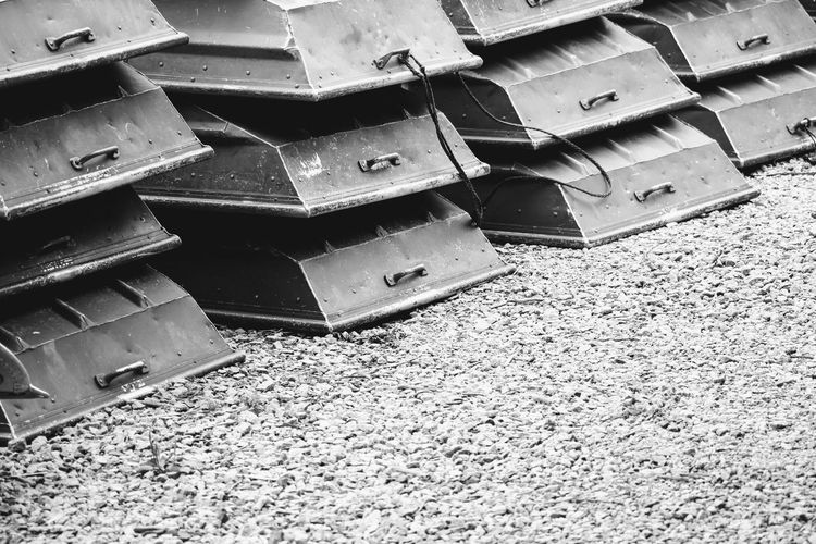 High Angle View No People Full Frame Day Close-up Tranquil Scene EyeEm Selects Closing Full Length Black Color Outdoors Taking Photos Enjoying The View Tranquility Blackandwhite Photography EyeEm Scenics Lake Water Boat Gravel Black & White Abstract Stacked Up Linear