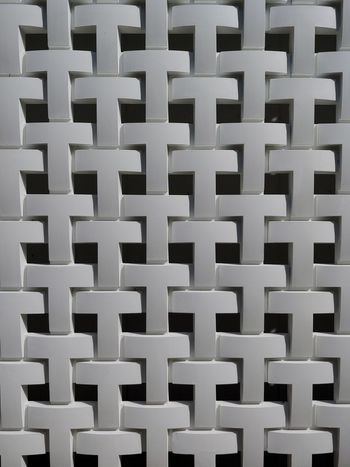 woven concrete blocks print the outside of a building in Tokyo, Japan. Building Materials JAPANESE Design Repeating Patterns Black And White Abstract Information Architecture Data Storage Full Frame Backgrounds Seamless Pattern Crisscross Geometry Architectural Detail Grid Repetition