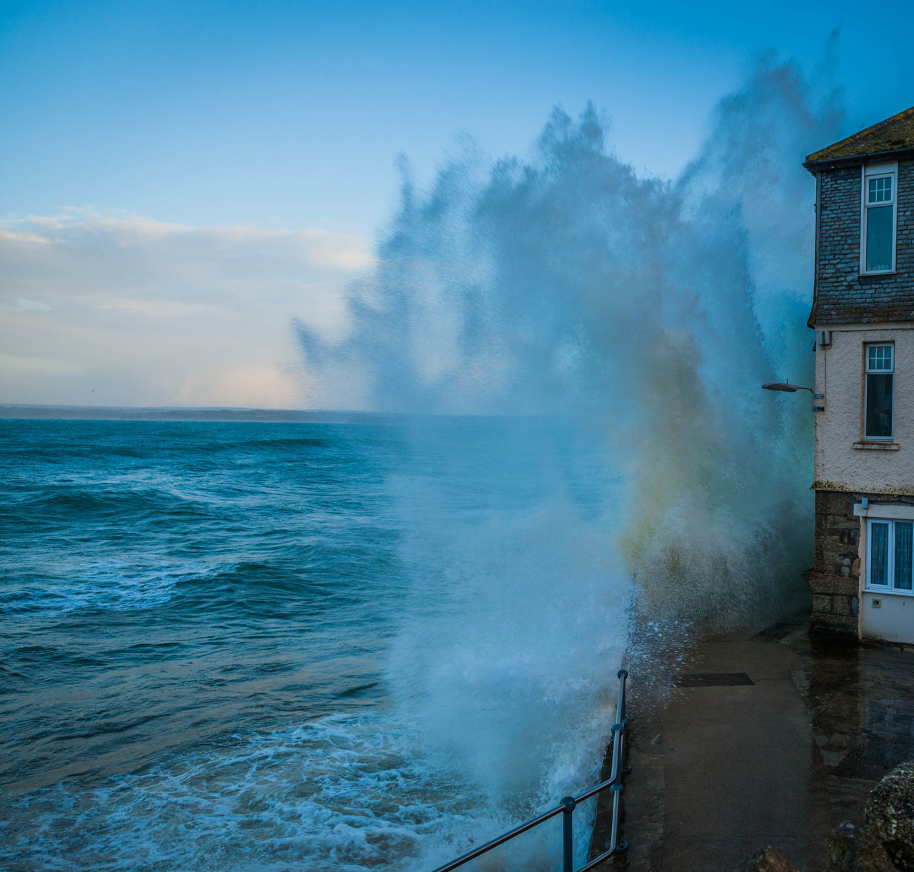 sea, water, motion, power in nature, no people, day, outdoors, force, built structure, architecture, nature, sky, beauty in nature, building exterior, wave, horizon over water, crash