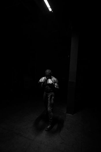 Boxing light Black And White Blackandwhite Photography Blackandwhite Montréal Streetphotographers Fuji Fujifilm_xseries Colors Youth Of Today Faces Of EyeEm PortraitPhotography portrait of a friend Portraits Portraiture Fitness Journalism Real People One Person Full Length Men Lifestyles Architecture Indoors  Illuminated Standing Young Men Leisure Activity Rear View Casual Clothing Clothing