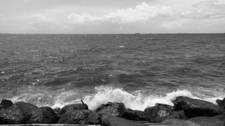 Sea Horizon Over Water Wave Beach Nature Beauty In Nature Power In Nature Sky Breakwaters Sea Side Eyeem Philippines Black And White Photography Black And White The Week On EyeEm EyeEm Nature Lover EyeEm Best Shots Beauty In Nature