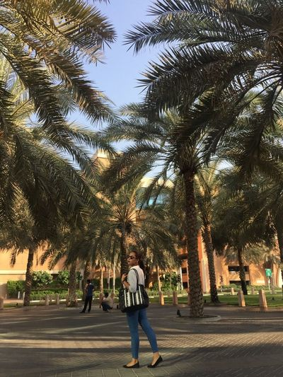 breaktime Adult Full Length Lifestyles Outdoors Palm Tree Tree Walking Women