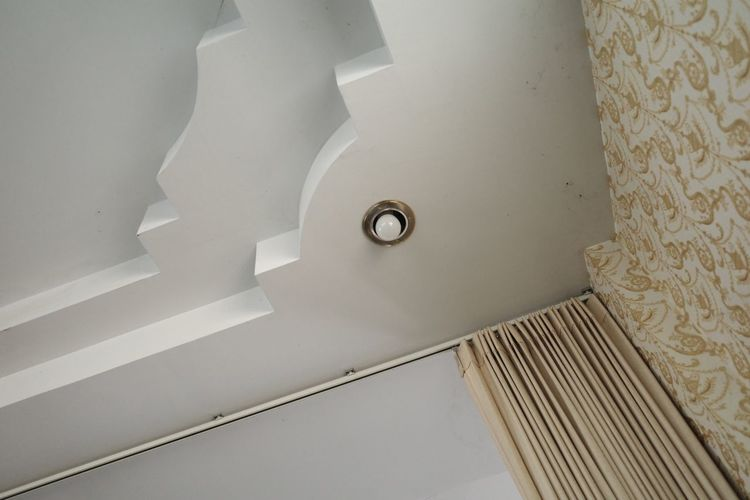 High angle view of electric lamp on wall at home