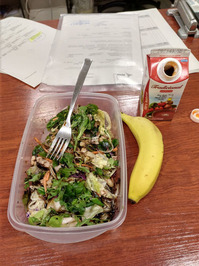 Having my launch at work Banana Drink Food Food And Drink Fork Freshness Gaspacho Healthy Eating High Angle View Indoors  Launch Launch Break Launch Time Papers Salad Table Tetrabrick Tupperware Vegetable First Eyeem Photo