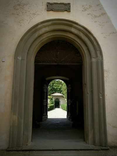 Archway leading towards building