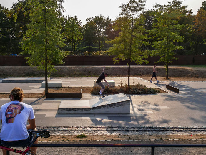 URBANANA #urbanana: The Urban Playground Skateboarding Available Light Child Childhood Day Grinding Group Of People Growth Leisure Activity Lifestyles Men Nature Outdoors Park People Plant Real People Sitting Streetphotography Transportation Tree urban sports Watching Water