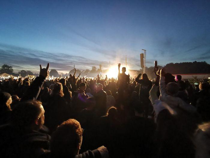Crowd at concert during dusk