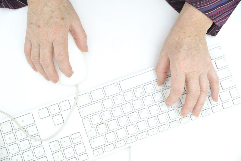 Cropped image of person typing on computer keyboard