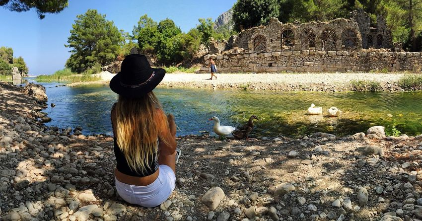 Olympos Sunlight Tree Women Nature Outdoors Real People Animals In The Wild Beauty In Nature Bird One Animal Day Leisure Activity Animal Wildlife Water Travel Destinations Mammal One Person One Woman Only Human Body Part Beach