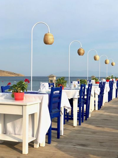 Great dinner location Table Seat Sky Chair Lighting Equipment Nature Food And Drink Decoration Arrangement Restaurant Celebration Architecture Sea No People Event
