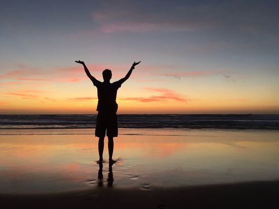 Done That. Sunset Beach Silhouette Sky Water Nature Arms Raised Orange Color Beauty In Nature Standing One Person Leisure Activity Horizon Over Water Real People Lifestyles Tranquil Scene Scenics Full Length Outdoors Done That.