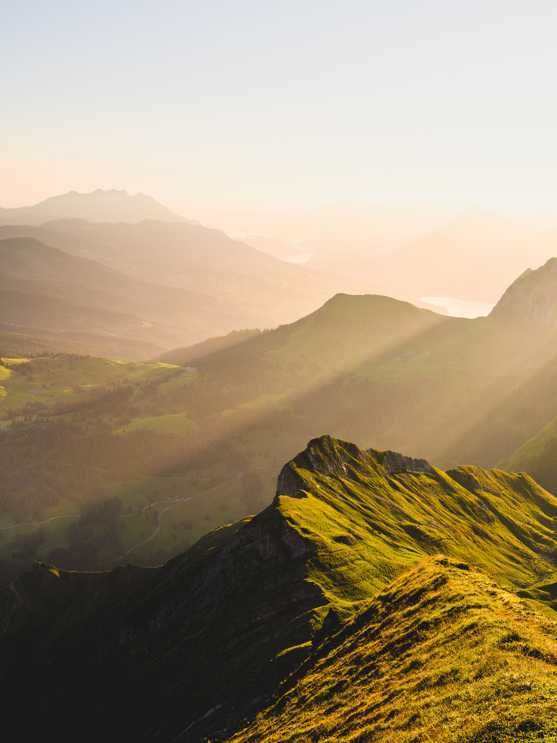 mountain, beauty in nature, scenics - nature, tranquil scene, tranquility, environment, sky, non-urban scene, mountain range, landscape, idyllic, nature, no people, fog, sunset, remote, outdoors, sunlight, day, mountain peak