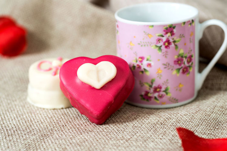 Candies by cup on burlap