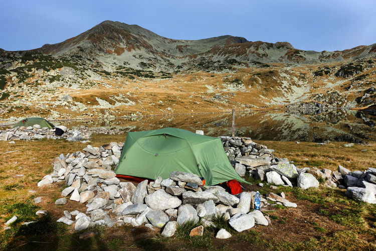 Tent on land against mountain