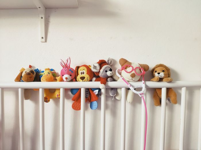Multi colored toys on shelf