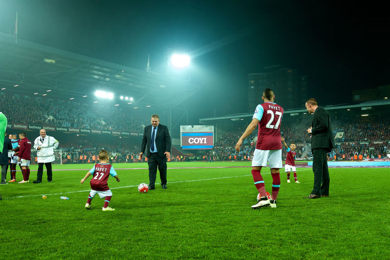 dimitri payet with his children after the last game at the boleyn ground Boleyn Boleynground Dimitri Dimitri Payet Enjoyment Field Fun Grass Grassy Green Green Color Hammers Irons Leisure Activity Lifestyles Outdoors Park Playing Soccer Soccer Game Sport Uptonpark West Ham West Ham Fans West Ham Utd